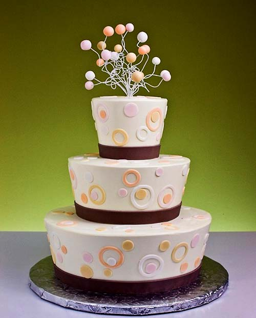 Three tier white and brown fun wedding cake design