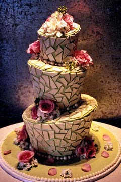 Creative and unique three tier topsy turvy wedding cake decorated with mosaic patterns