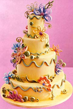 Four tier funky and groovy yellow wedding cake