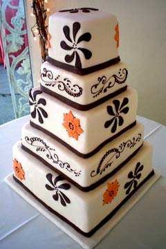 Five tier 1970's style white, orange and black super cool wedding cake