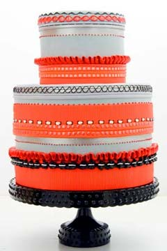 Two tier orange, white and silver retro wedding cake