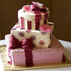three tier pink, white and burgundy gift box wedding cake