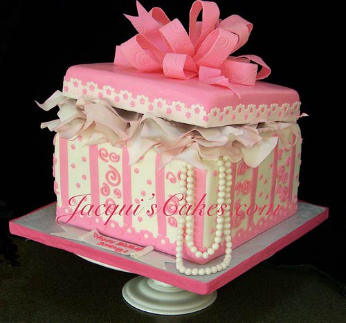 Gift box cake designs shaped like a present white and pink one tier gift box wedding cake is decorated with pink polka dots and swirls and real looking sugar paste pearls negle Image collections