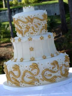 Three tier gold and white unusuall7 shaped wedding cake