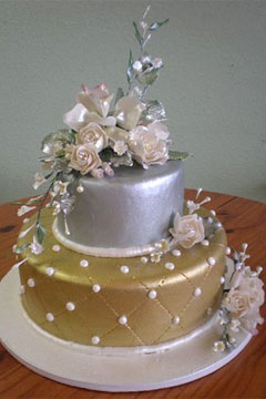 Small two tier silver and gold cake