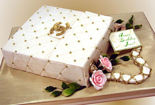 gold and white cake is created in the shape of a Channel purse