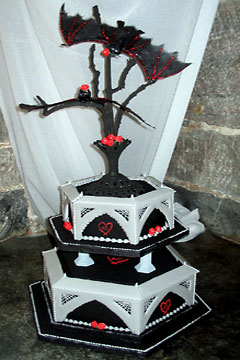 Three tier black wedding cake made to look like a spooky wedding cake