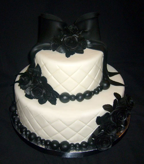 Two tier white and black Gothic cake, decorated with black sugar paste roses