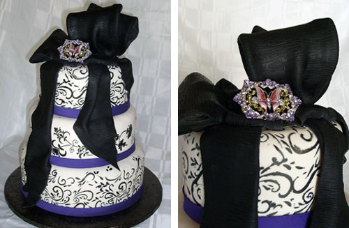 Striking three tier black and purple Gothic style wedding cake drapped with black fondant ribbon