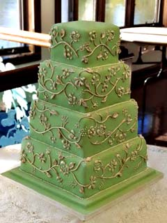 Square four tier green and gold brocade fall wedding cake