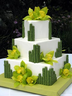 three tier square white and olive green wedding cake