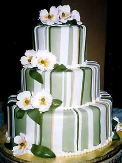 three tier round striped green and white wedding cake