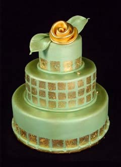 Round three tier green and gold retro style fondant wedding cake, decorated with gold leaf style