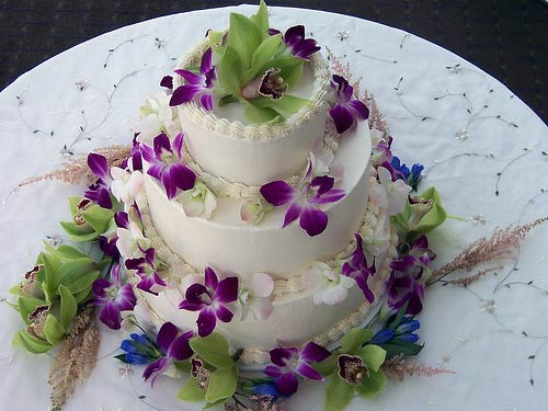 Three tier tropical white buttercream wedding