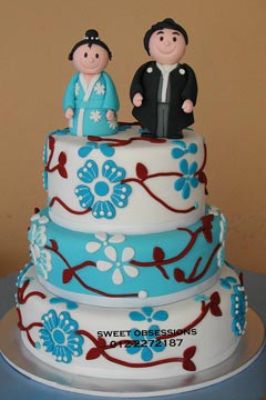 Japanese theme, three tier white and blue fondant wedding cake