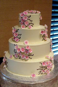 Simple four tier pink cherry blossoms ivory wedding cake