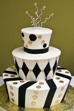 Three tier mad hatter black and white weddiing cake decorated with silver polka dots