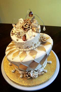 Two tier, mad hatter, white and gold wedding cake