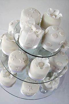 Rolled fondant mini white individual wedding cakes