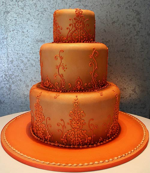 Three tier orange rolled fondant wedding cake