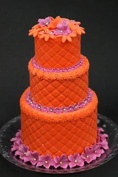 Small three tier retro orange and pink funky wedding cake