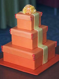 Three tier square orange gift box wedding cake made to look like a present