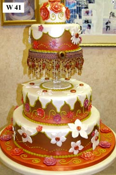 Two tier art deco white and orange wedding cake is so stunning