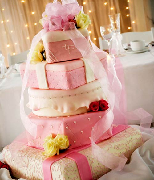 five tiered white and pink wedding cake