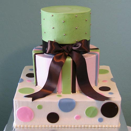Three tier green, pink and white stripes and polka dot cake