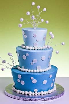 Three tier funky blue wedding cake decorated with white polka dots