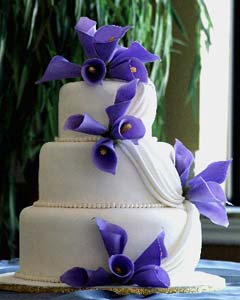Three tier purple and white fondant wedding cake