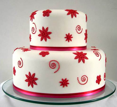 Red wedding cakes gallery classic and simple two tiered white and red wedding cake decorated with accents of red fondant decorations these decorative elements are red swirls junglespirit Image collections