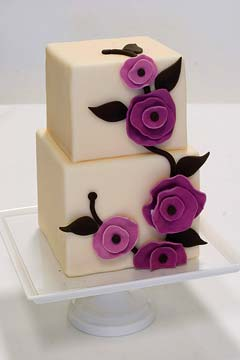square two tier 1930's inspired wedding cake decorated with pinkish purple hand made fondant florals