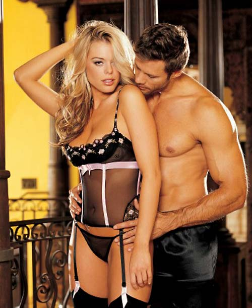 blonde model wearing sexy honeymoon lingerie in black and pink