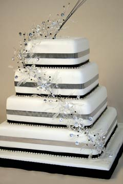 Four tier silver, black and white square wedding cake