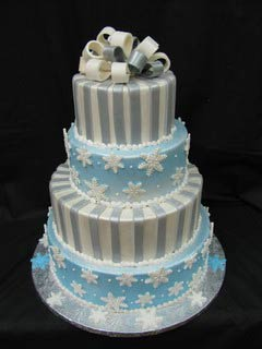 four tier white, silver and blue snowflake wedding cake
