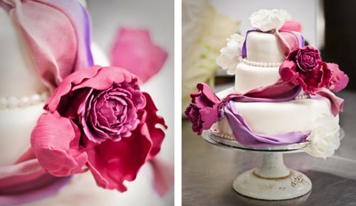 Small, round romantic three tier fondant wedding cake decorated with the colours of spring