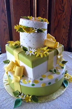 Three tier, green, white and yellow theme gift box wedding cake design