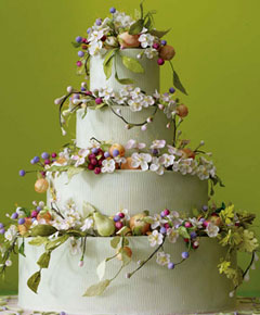 Four tier floral cake with fresh flowers