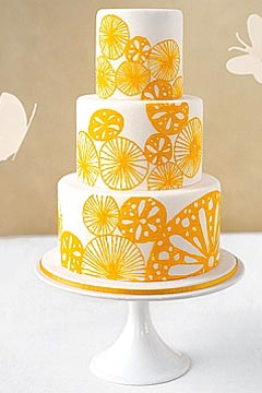 Simple And Refreshing Three Tier White Yellow Wedding Cake Decorated With Hand Painted Lemon Citrus Shapes All Over The