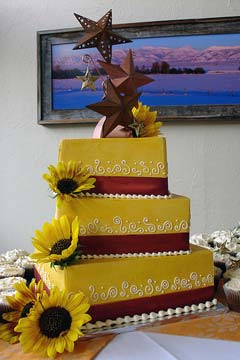 Three tier square yellow wedding cake with big yellow sunflowers