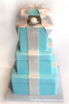 Three tier Tiffany Blue engagment ring box wedding cake with a diamond ring in it