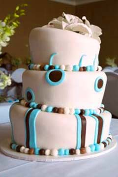 white and blue topsy turvy cakes