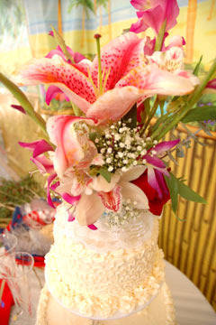 Two tier buttercream wedding cake with a tropical wedding cake topper