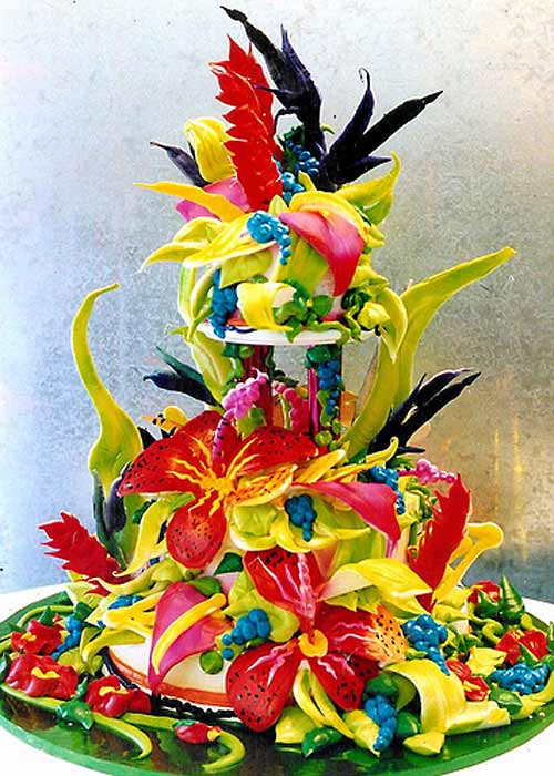 Two tier, tropick Birds of Paradise summer theme wedding cake, all edible chocolate, sugar flowers