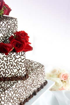 Angled off centre, square wedding cakes with brown buttercream swiggles and swirls