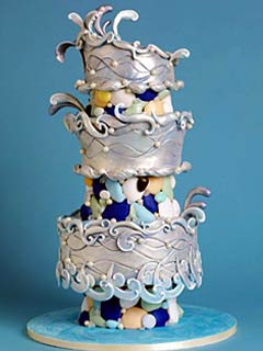 Unique, three tier silver and blue wedding cake, decorated with interesting forms of fondant