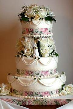 Three tier Viictorian style roses and lace wedding cake