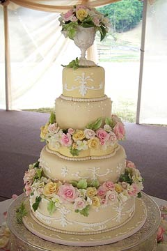 Four tier cream Victorian sytle rolled fondant wedding cak