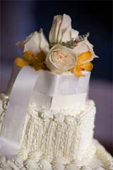Wedding cakes with fresh flowers as toppers